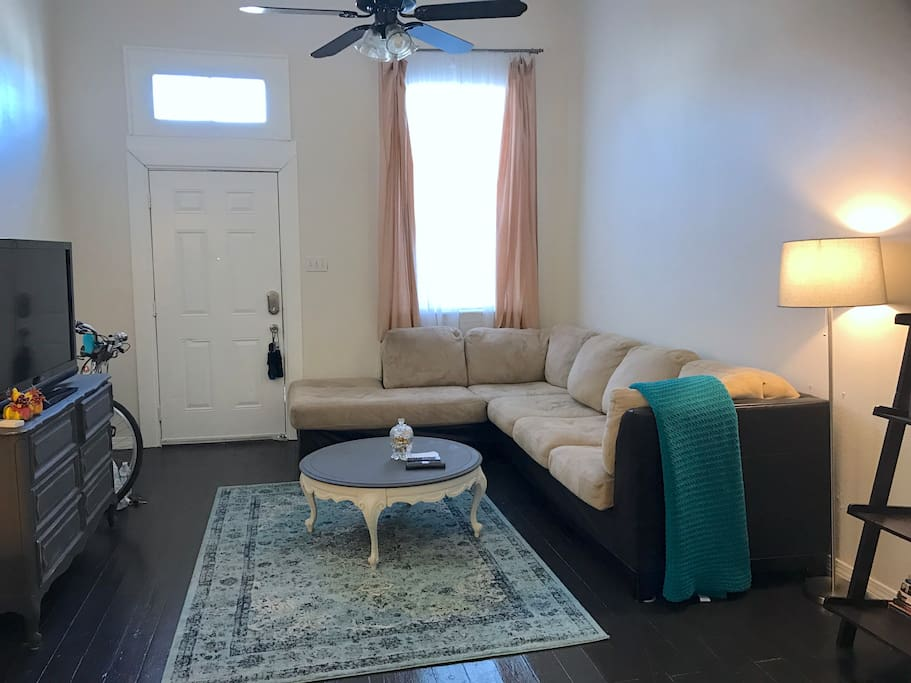 Living room has a microfiber sleeper sofa with chaise that has a pullout bed. The sofa could sleep 2-3 comfortably with the bed pulled out.