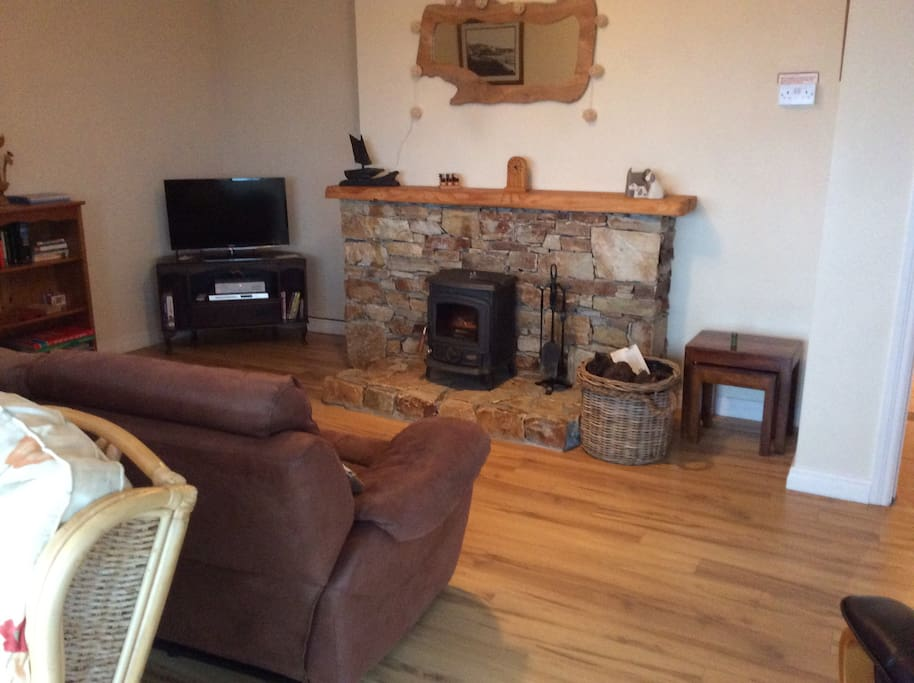 Sitting room with traditional turf burning stove