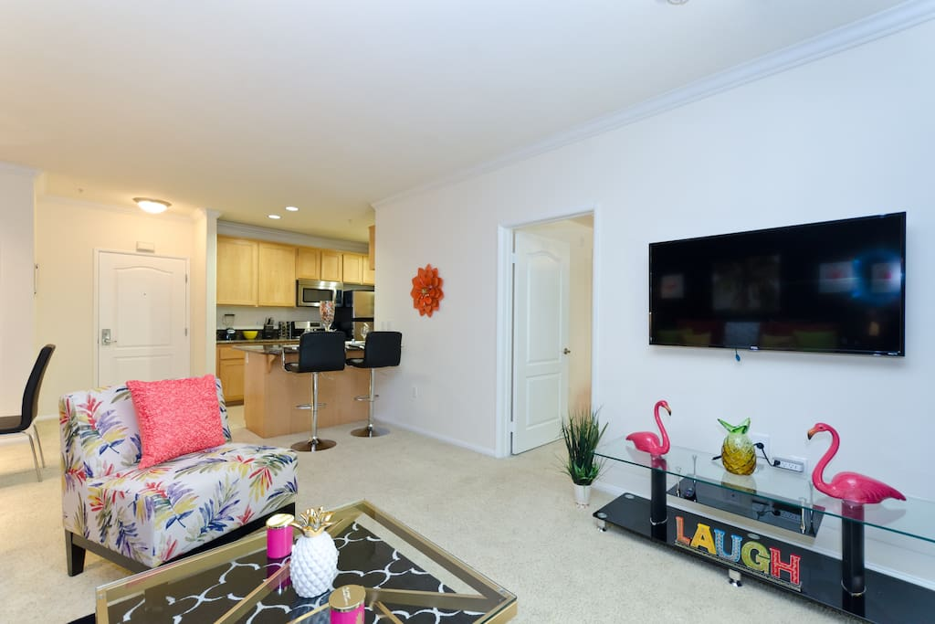 Spacious living room with HD TV and  beautiful decor