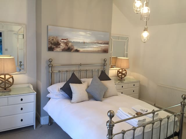Master bedroom with ensuite bathroom and views of the beautiful Warkworth Castle.