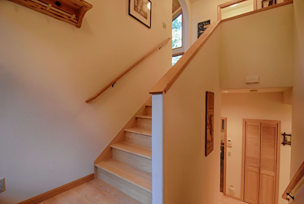 Foyer: Up leads to the main floor down to bedrooms, laundry & garage