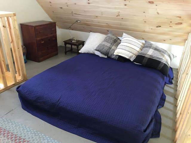 Queen size bed in sleeping loft