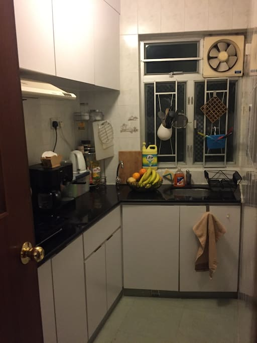 Fully functional kitchen with refrigerator and stove.