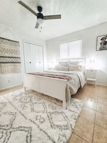 Comfy Queen Bedroom with fluffy pillows, plush bedding, and double closets for settling in on longer visits.