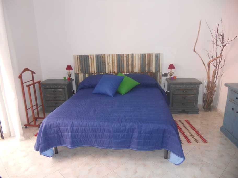 The room: bedroom with a double bed and a single bed