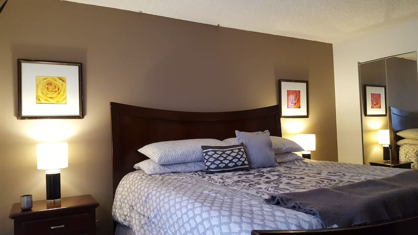 Bedroom: Features a California King Size Bed