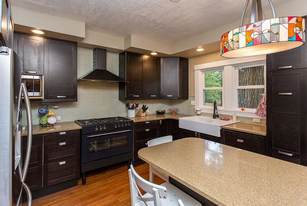 Updated kitchen with gas stove/range, dishwasher, fridfe/freezer, and microwave.