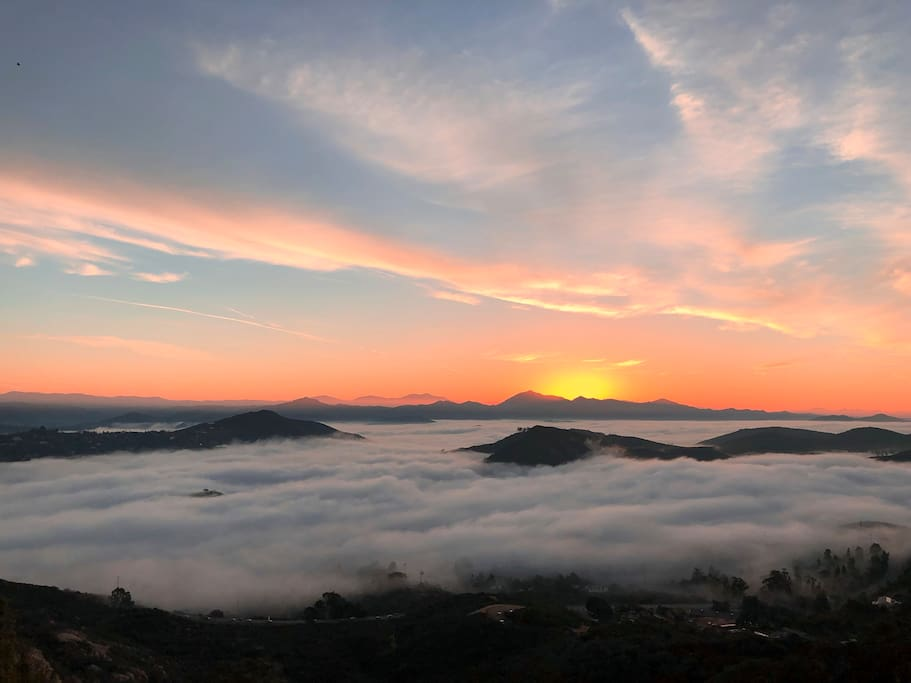 On the deck at sunrise above the clouds enjoying morning coffee.