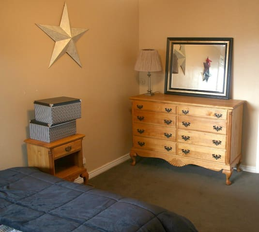 The bedroom includes a large closet and storage space for luggage, etc.