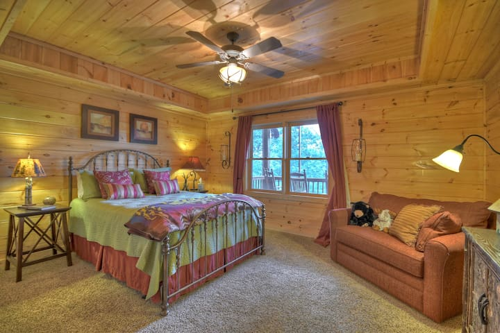 Terrace level bedroom.   Queen bed and a large chair  that opens to a twin bed for more sleeping options