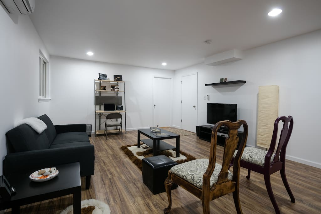 """Living room with 42"""" cable ready TV and work station. Sofa folds down and allows for two additional guests."""