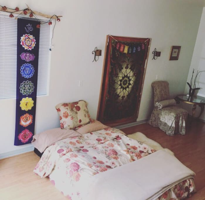 "Futon Mattress. 6"" deep. Cozy duvet.  Light warm yoga studio.  Good energy"