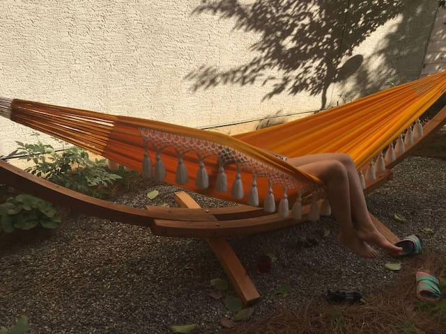 Summer is here. Hang out in our garden and watch the flowers bloom. Hammock is both a noun and verb. Ex. On days like this one should hammock and work from hammock.
