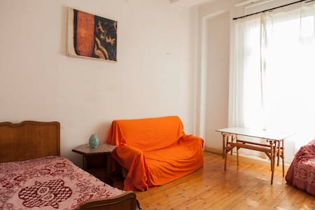 Sunny  room in authentic Garden City apartment.