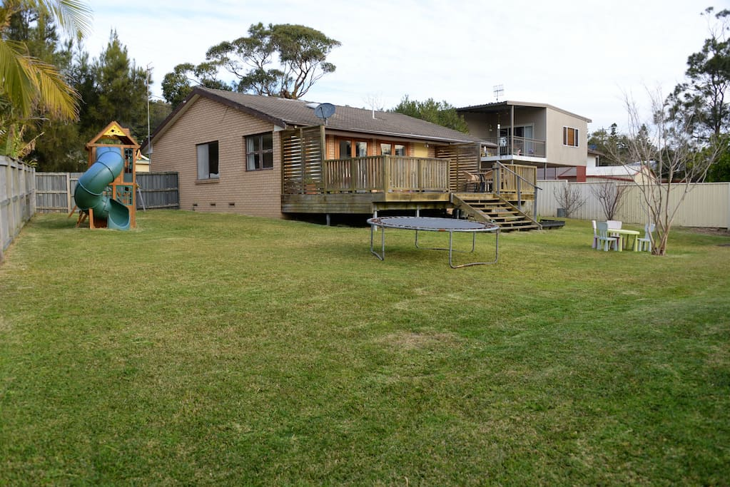 Large fenced flat backyard