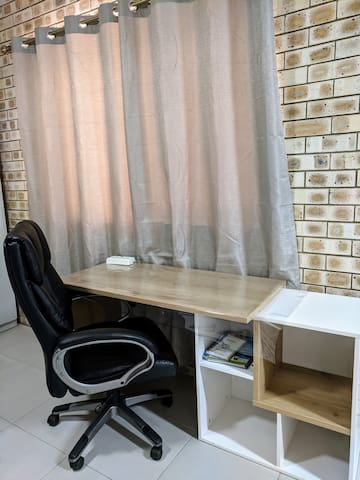 Work/computer desk with a comfy office chair. The chair isn't new, but still functional.