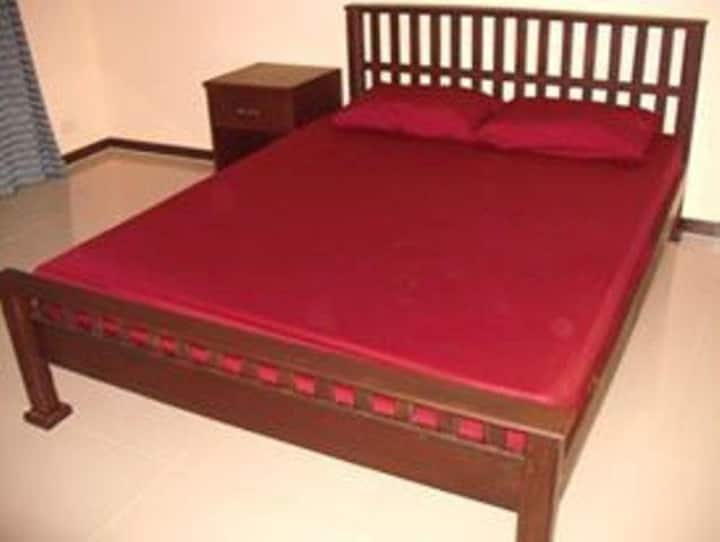 Queen size bed located in quiet location