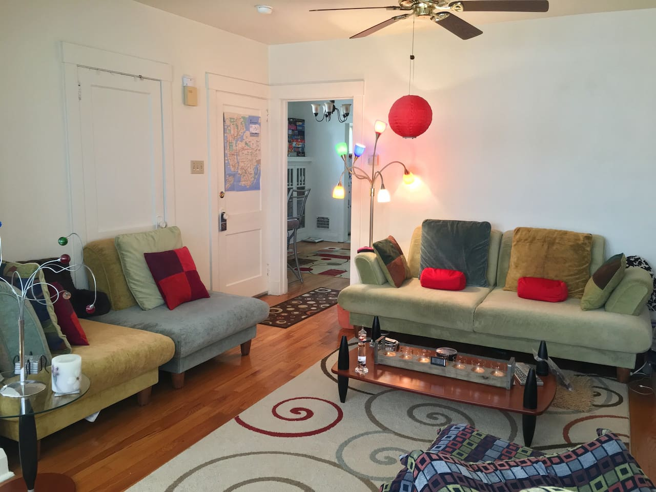 living room (sleeps 2-4 extras) .  sofa arms and backs are removable leaving a firm cushy bed like sleep space wider than a twin/single.  same goes for chairs, backs come off (there are no arms).  room for self inflating queen airbed with foam topper