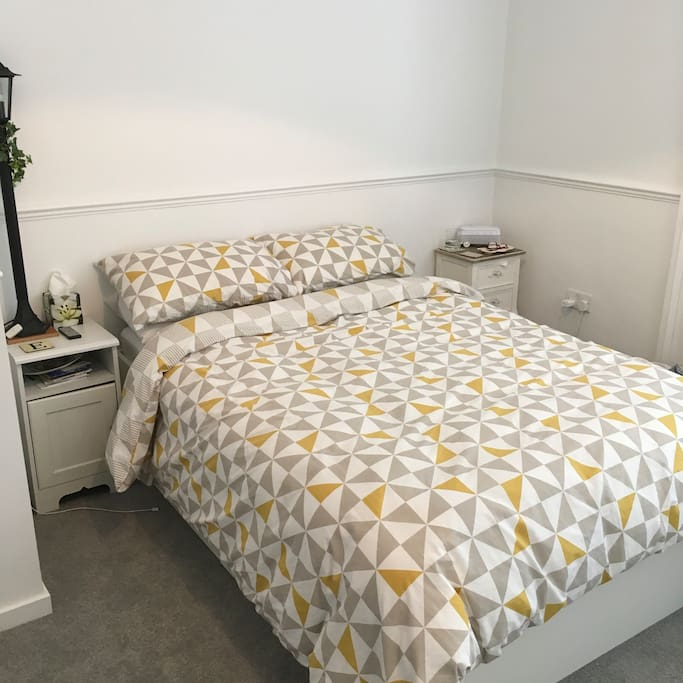 Comfortable double bed in spacious bedroom