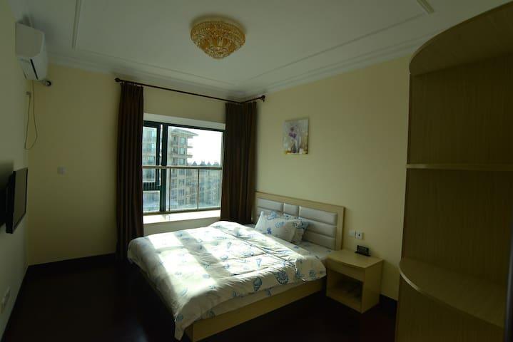 启东碧海蓝天假日公寓温馨家庭套房 - Nantong