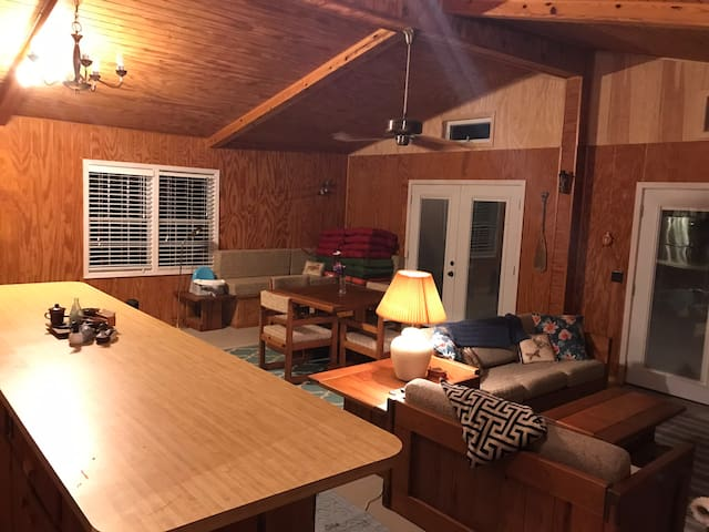Large open living area with lots of seating. Cozy lake life.