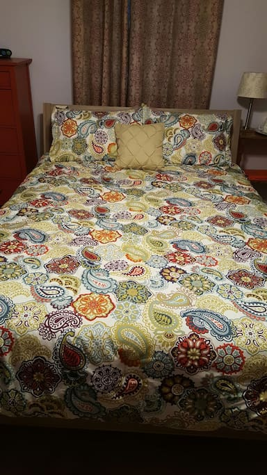 A queen mattress with 3 inch foam topper and plenty of pillows!
