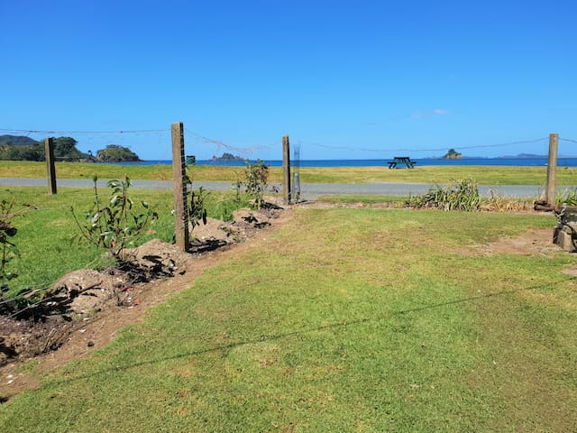A flat grassy area with the best part of the beautiful oakura Bay right in front of you!