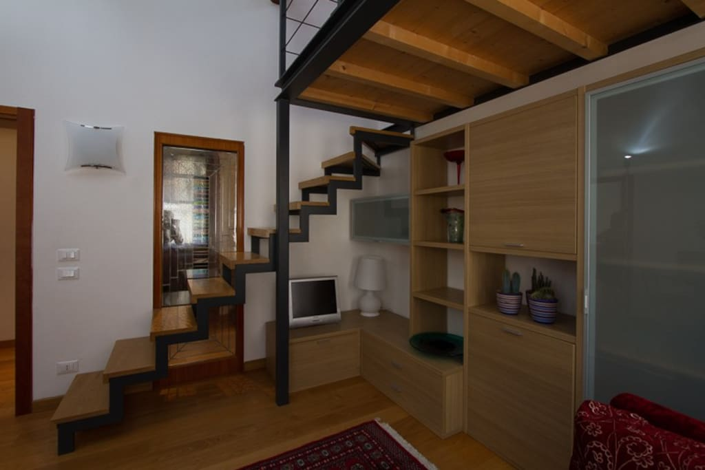 you enter the loft with open staircase