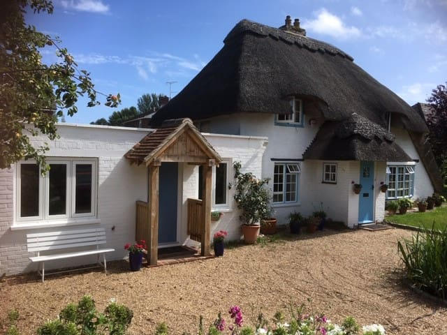 Modern apartment attached to traditional cottage