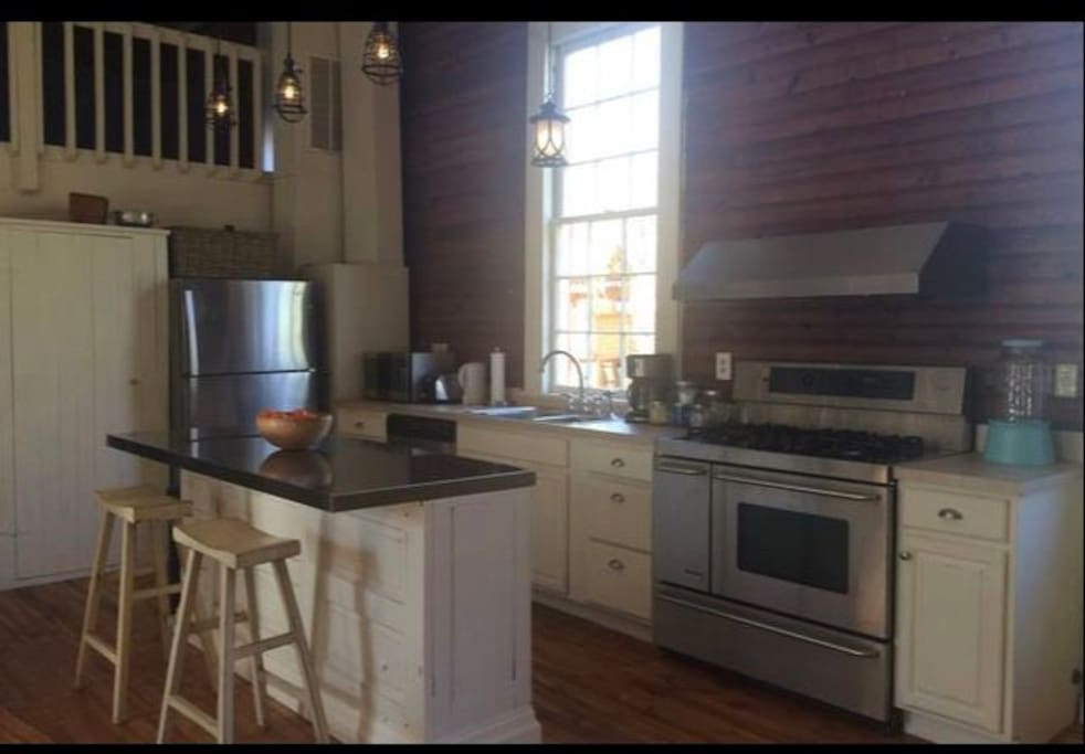 Fully-equipped kitchen with new appliances and gas stove