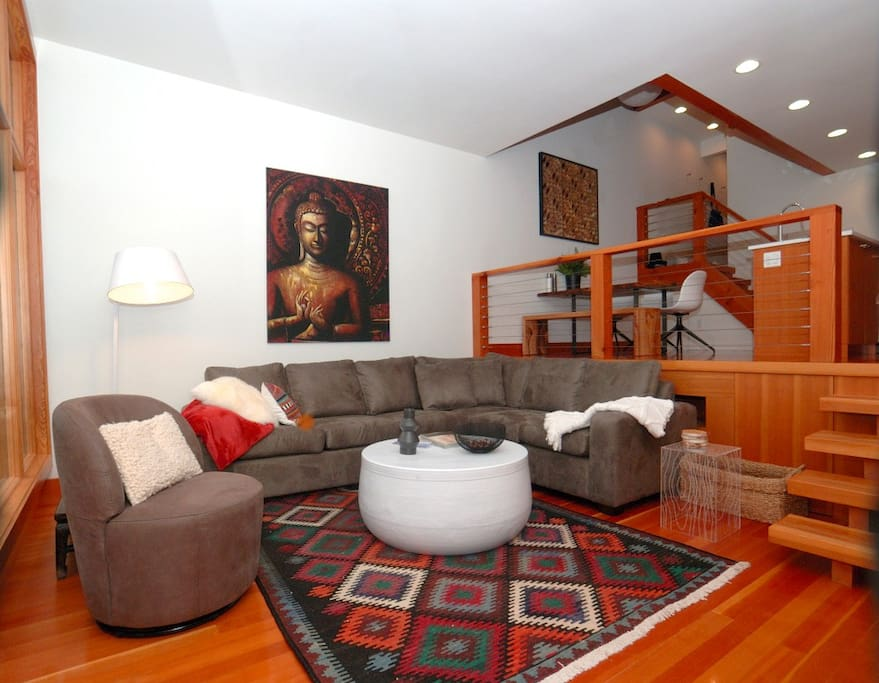Living room with custom furniture, rugs and wall decor