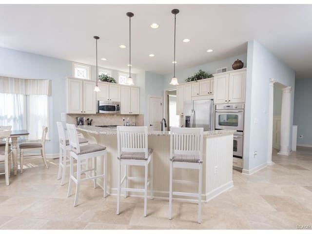 Gourmet Kitchen w stainless Steel Appliances and Granite Countertops and 10` Ceilings