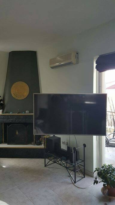 "55"" TV Fireplace and Home Cinema on Living Room"
