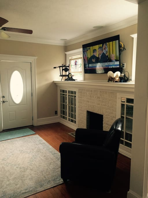Living room area with big screen TV