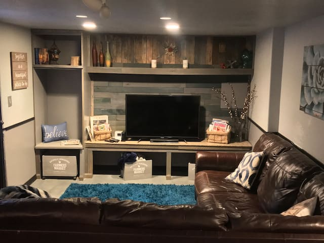 """Enjoy watching a movie on the 52"""" smart tv, while chilling out on the large and comfy sectional."""