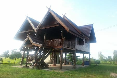 Traditional Thai house in ricefield - sanom