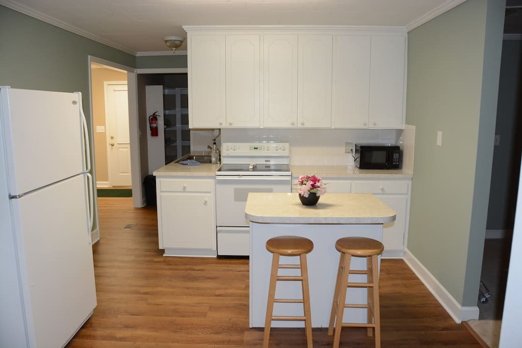 Kitchen includes refrigerator, microwave, dishwasher and stove. Space is shared with other guests.