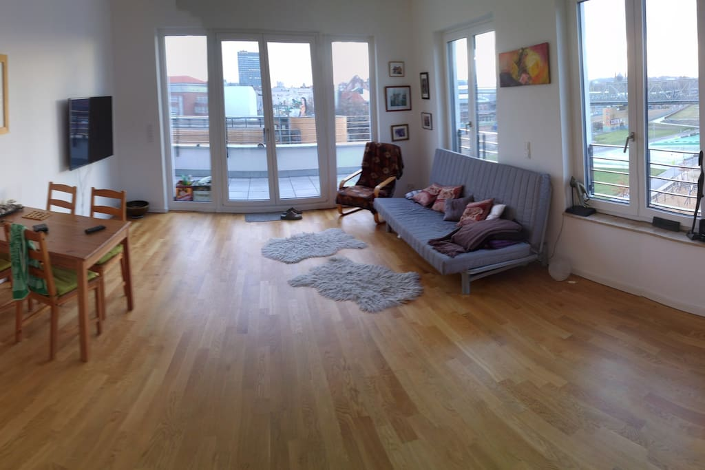 Great and spacious living room with large windows facing the park and city
