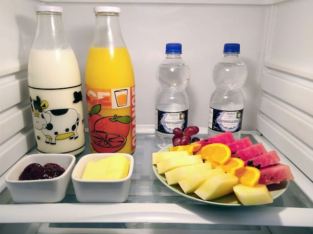 Your fridge comes stocked with freshly cut fruit, orange juice, milk and bottled water for your stay
