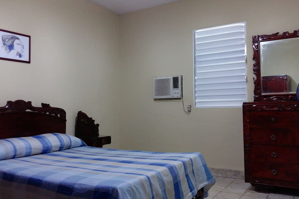 The room, equipped with a double bed and AC