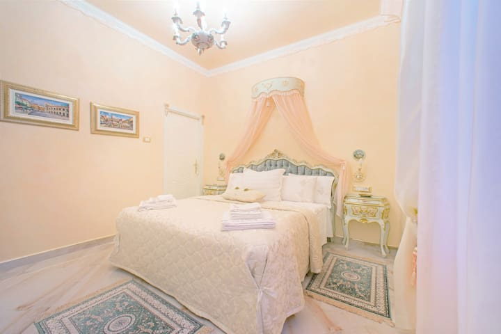 Comfortable master bedroom with king size bed and Smart TV