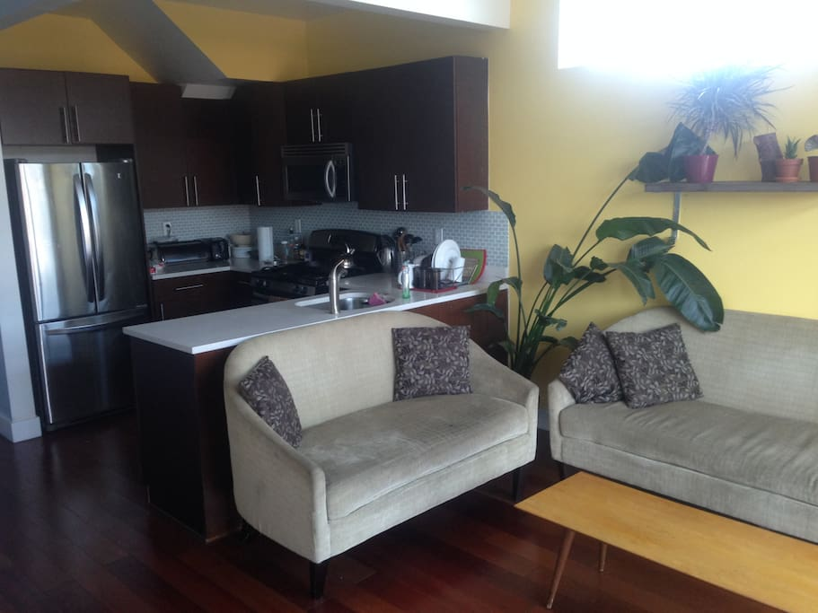 Kitchen and sitting area. Guests have use of fully stocked kitchen.