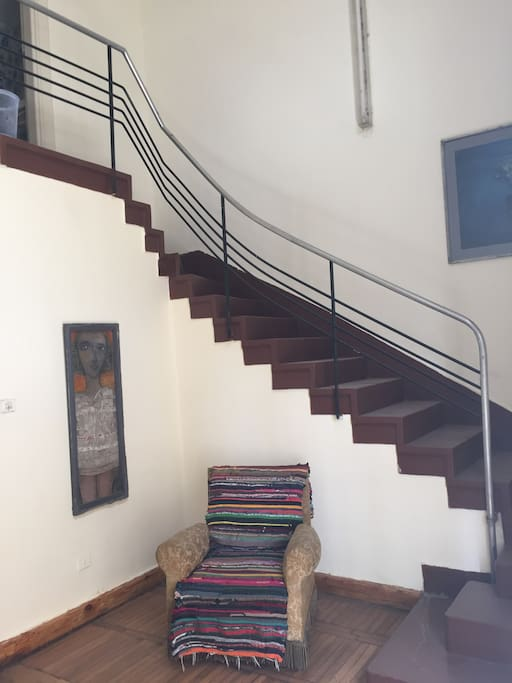 Staircase leading to the bedroom and bathroom