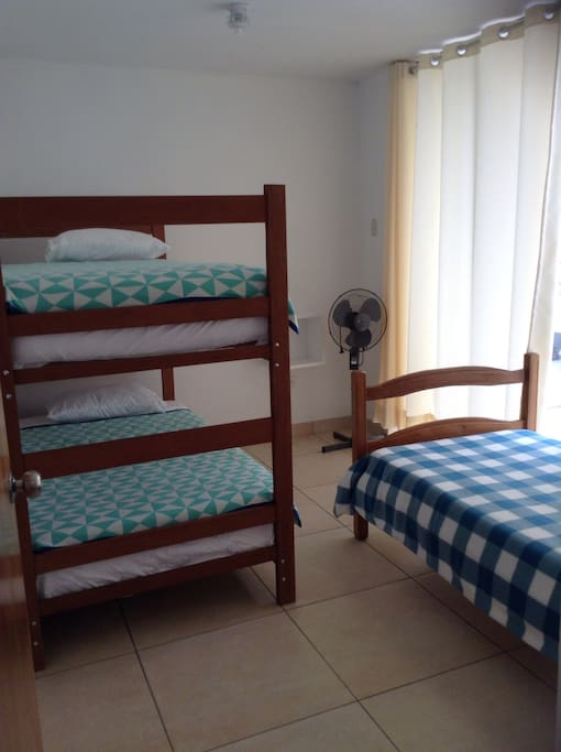 Twin bunk beds and single twin bed.