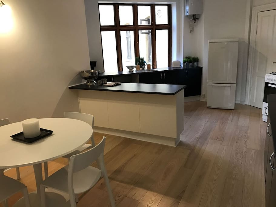 Big kitchen with dining area including dish washer and washing machine