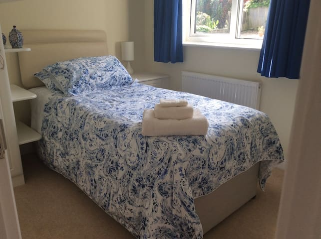 Single bedroom in bright detached house.
