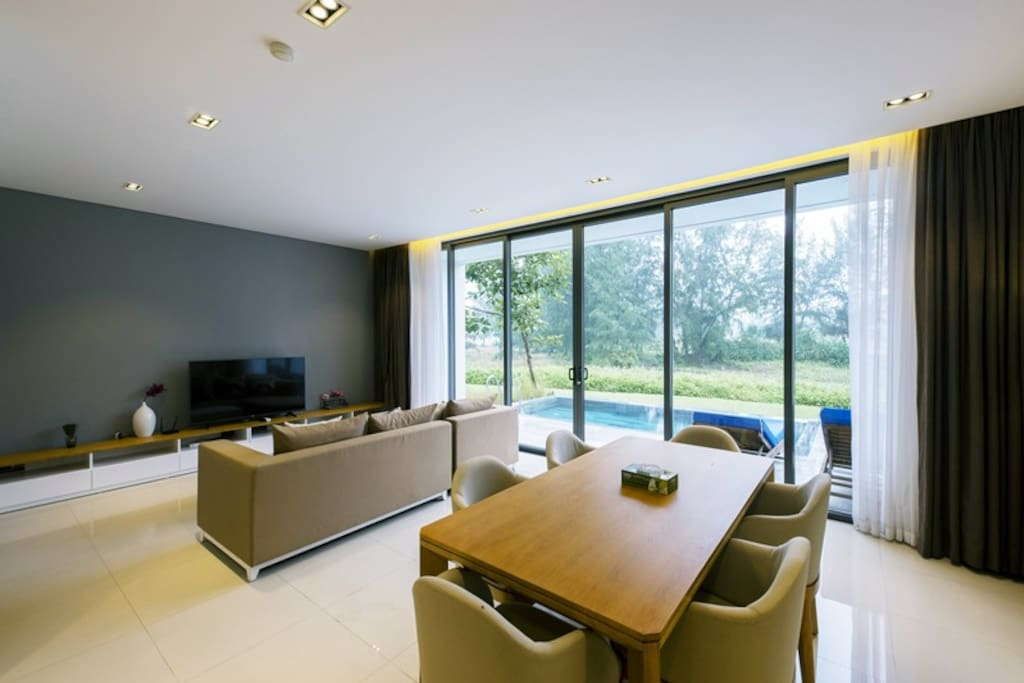 Living Room and Dining Room facing to the private pool