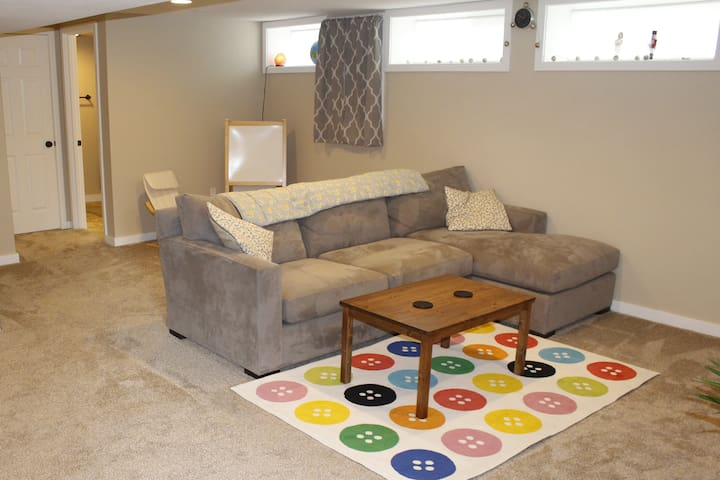 Living room with large sofa and coffee table.