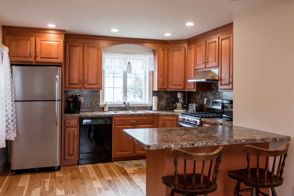 The updated kitchen features cherry cabinets and plenty of prep space on the counters.