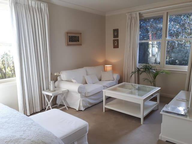 The room has a  private living area overlooking pool and garden.